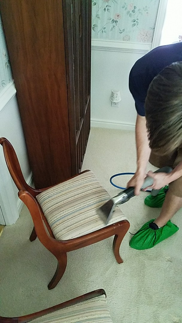 Richmond, VA - Here you see our tech hand cleaning these dining room chairs. Their cat had been sneaking up on them and leaving her hair balls. Yuck!!