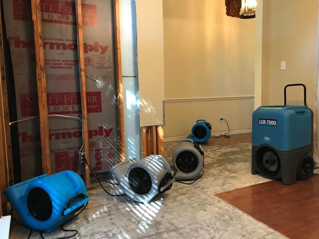 Addison, TX - Beginning water damage restoration at a home in Addison, Texas caused by rainwater.  The water intrusion caused damage to engineered hardwood floors, drywall and also insulation.