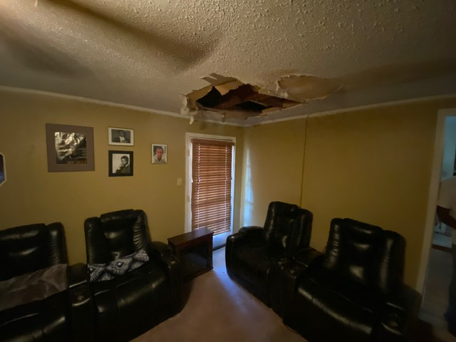Performing an inspection and free estimate at a home in Carrolton, Texas. The damage was caused by a sink drain line.