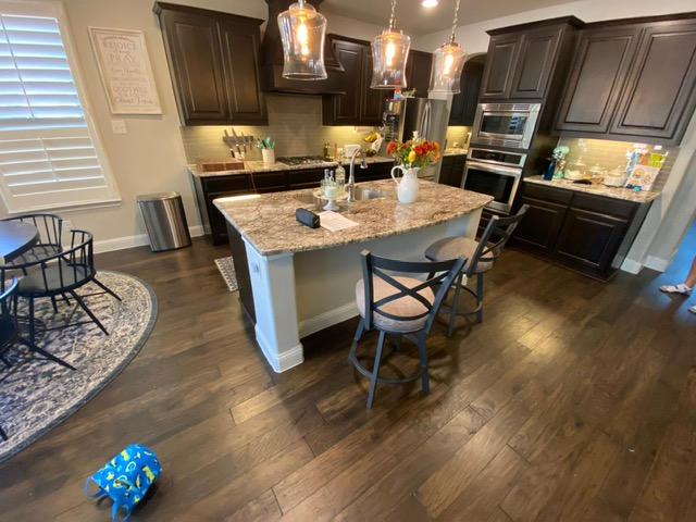 Performing a free estimate at a home in Little Elm, Texas after the dishwasher leaking causing damage to the kitchen island.
