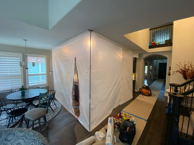 Set up a dust containment for our work area at the home that was damaged by water in LIttle Elm, Texas.
