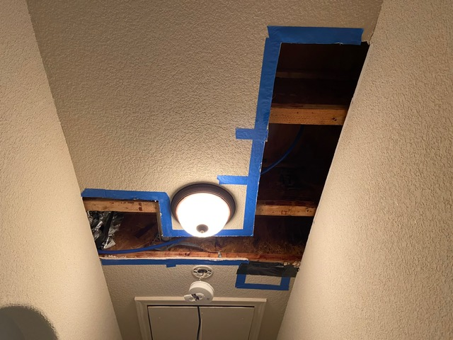 Dallas, TX - Doing a moisture inspection at a home in Dallas, Texas that was flooded by a broken toilet valve.