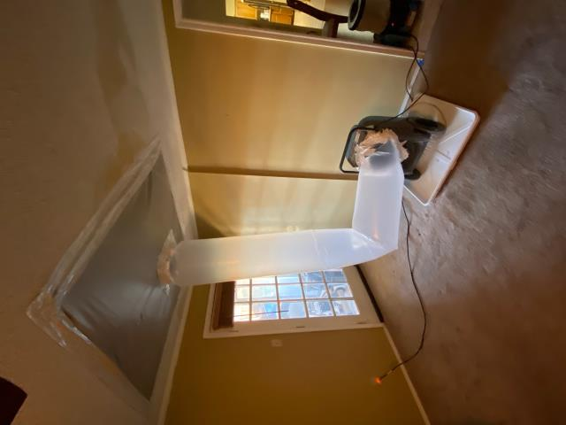 Setup mitigation equipment at water damage restoration job in Carrolton, Texas caused by an overflowed sink.