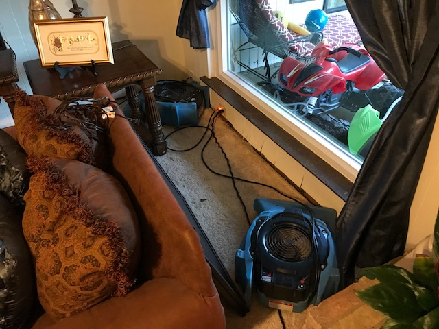 Arlington, TX - Starting water damage restoration at a home in Arlington, Texas after rain water caused heavy flooding.