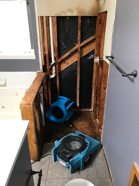 Starting water damage restoration at a home in Coppell, Texas after a shower pan failure caused leaking in the bathroom.