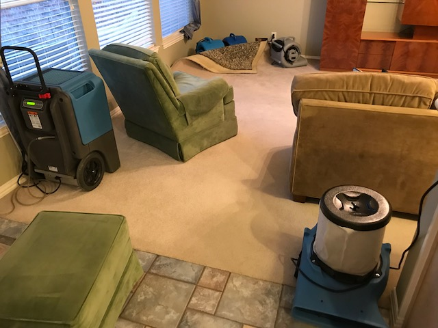 Starting water damage restoration at a home in Coppell, Texas after a slab leak caused damage to several rooms.