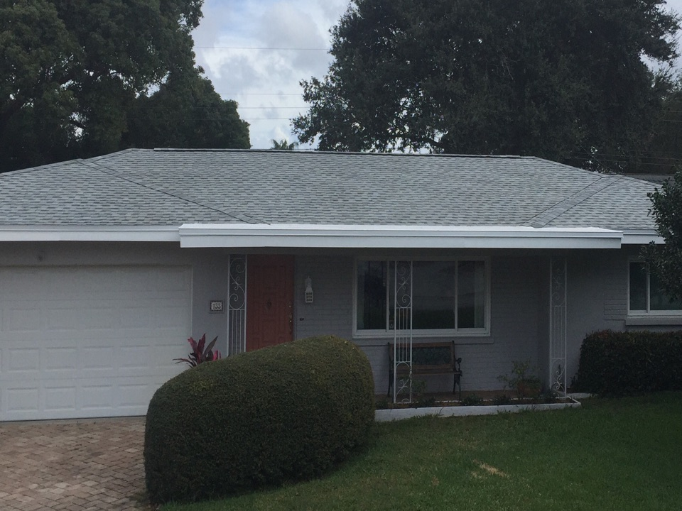Clearwater, FL - Arry's Roofing is collecting the final payment for this Clearwater customer's GAF shingle re-roof.