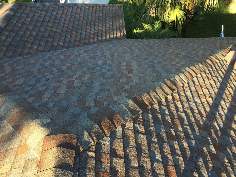 Clearwater, FL - Picking up the final payment for a GAF shingle re-roof that Arry's Roofing just completed.