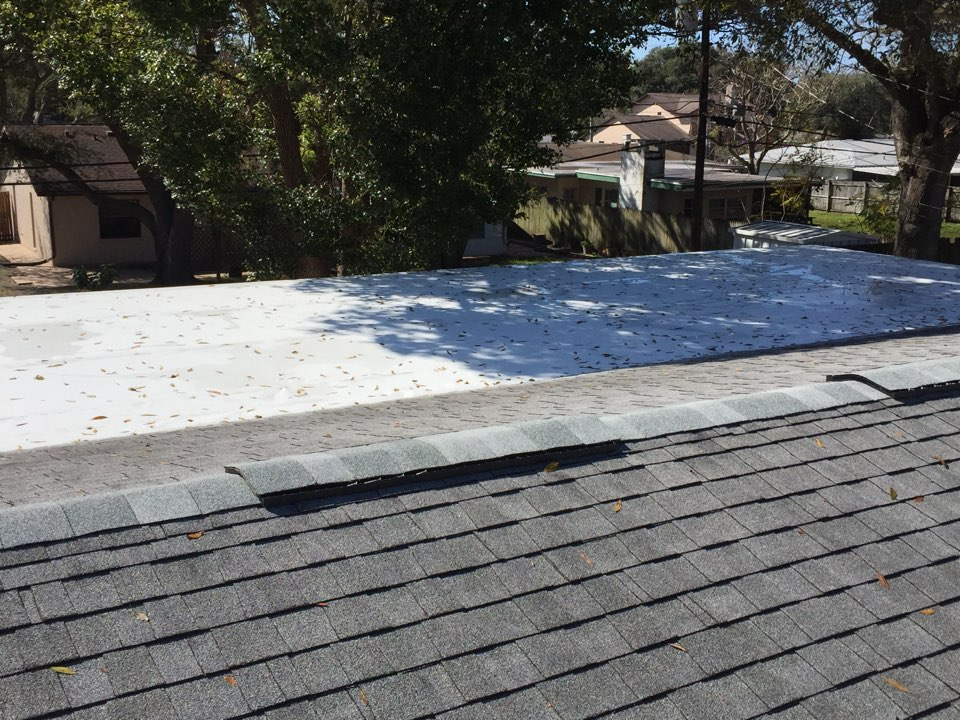 Clearwater, FL - Arry's Roofing installed a new GAF Everguard TPO flat roof, and replaced the vents on the shingle roof with GAF cobra ridge runner.