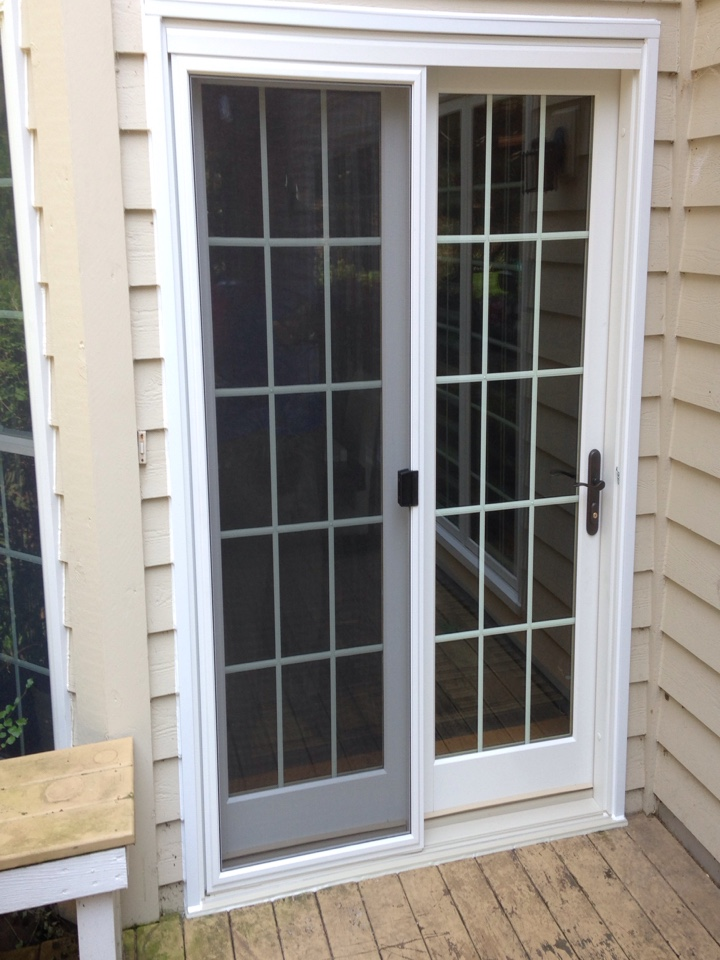 Aurora, IL - Marvin integrity hinged patio door with grids between glass