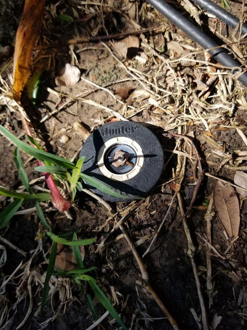 Replacing broken sprinkler nozzles.