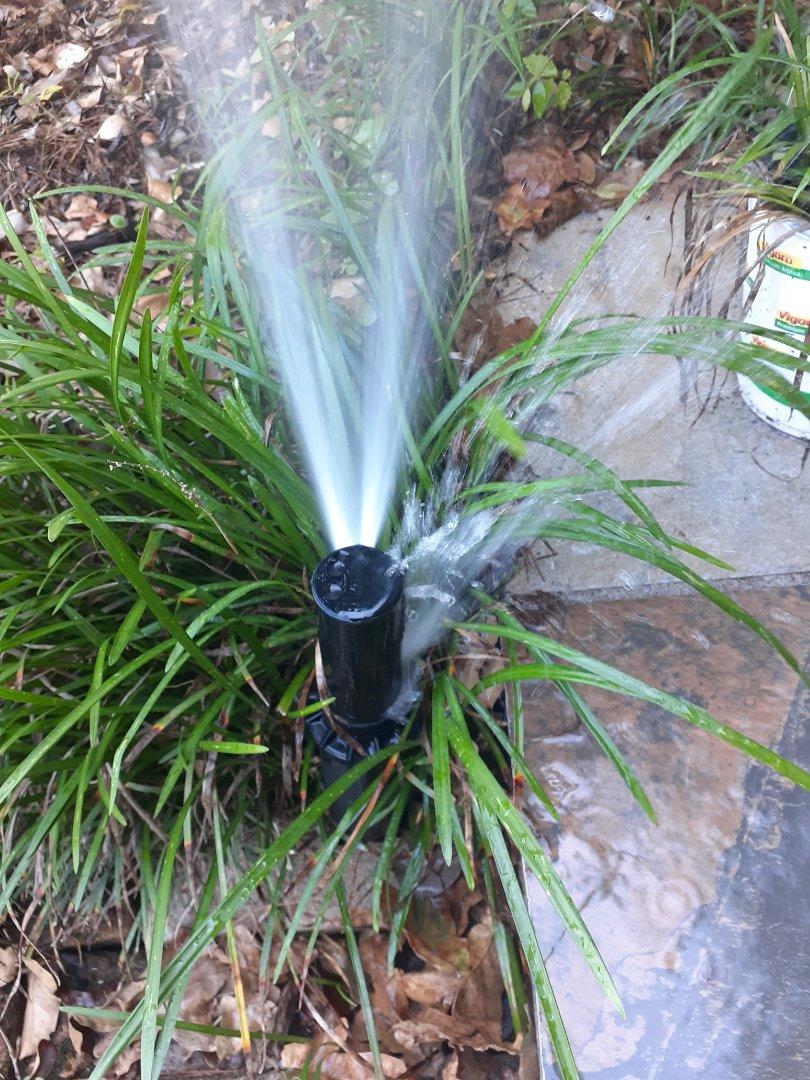 Replacing broken sprinkler rotors.