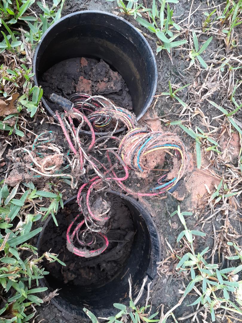 Repairing sprinkler wires.