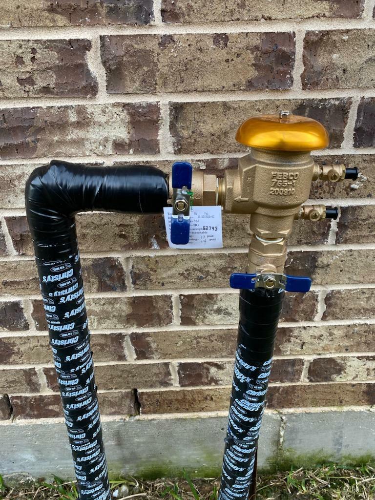 Cypress, TX - Replacing sprinkler backflows.