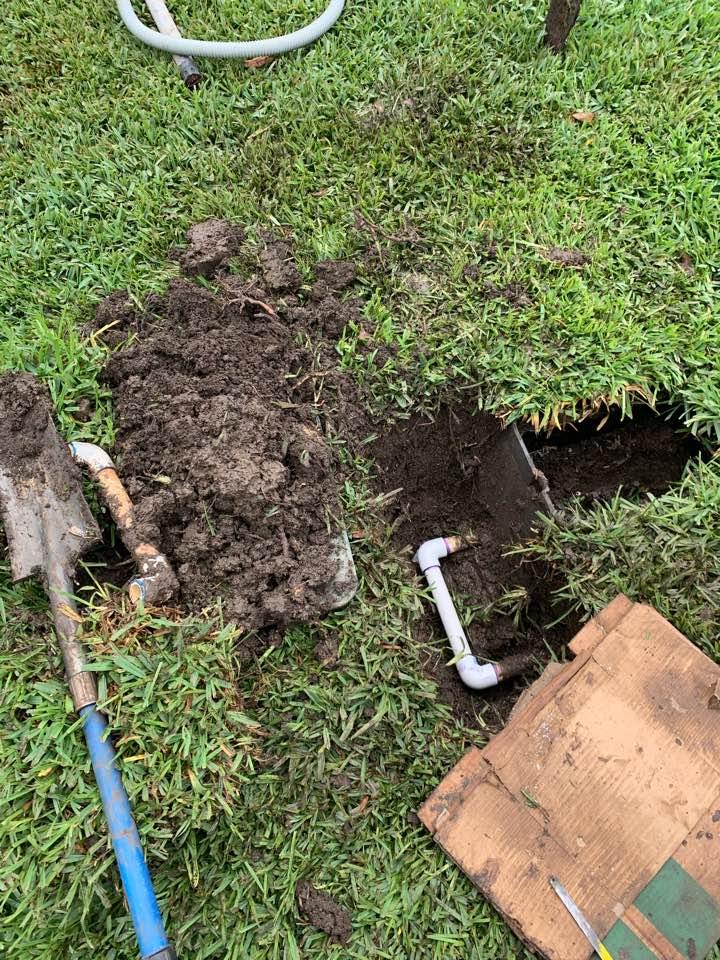 Repairing main line leak and replacing sprinkler heads