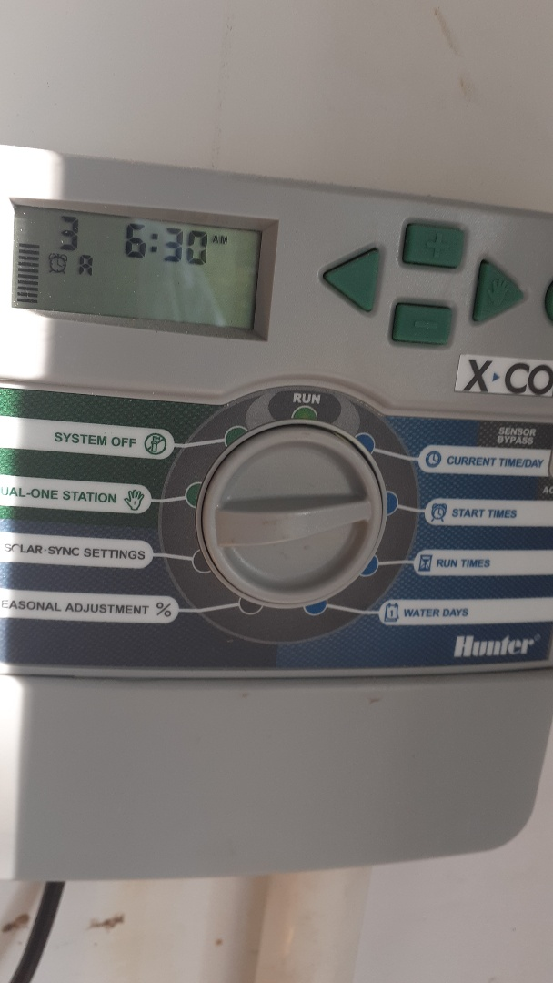 Cypress, TX - Checking sprinkler programming on controllers