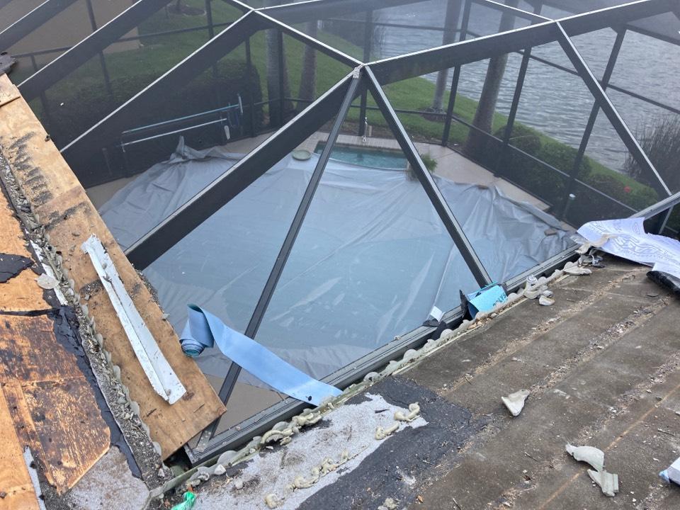 Sarasota, FL - Tear-off in-progress ( Pool covered )