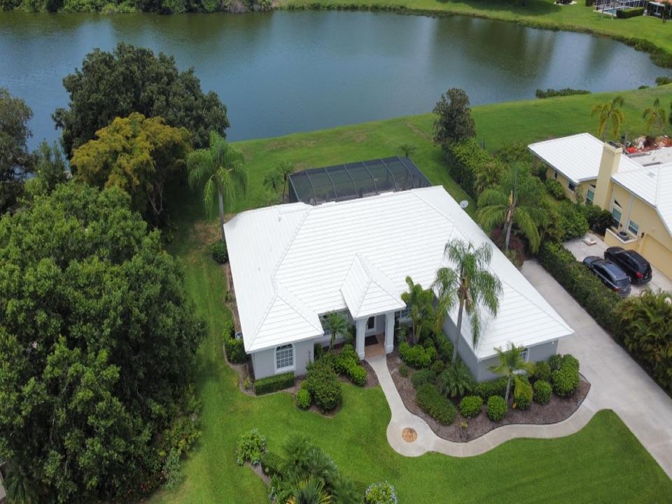 Sarasota, FL - Finished White Flat Tile Roof