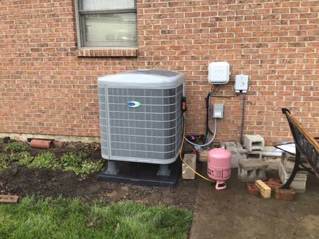 Waynesville, OH - I began a diagnostic on a Carrier heat pump with an electric air handler.  Determined that the heat pump was completely frozen.  Unit has to defrost before diagnostic can be completed.  I switched client to emergency heat.  Return service is necessary after unit has thawed.