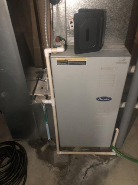 Springboro, OH - I found that the furnace trap is leaking from the hose. I recommend to replace hose and the furnace trap. Customer has opted to replace the 2002 Carrier gas system. Furnace is running at time of departure.