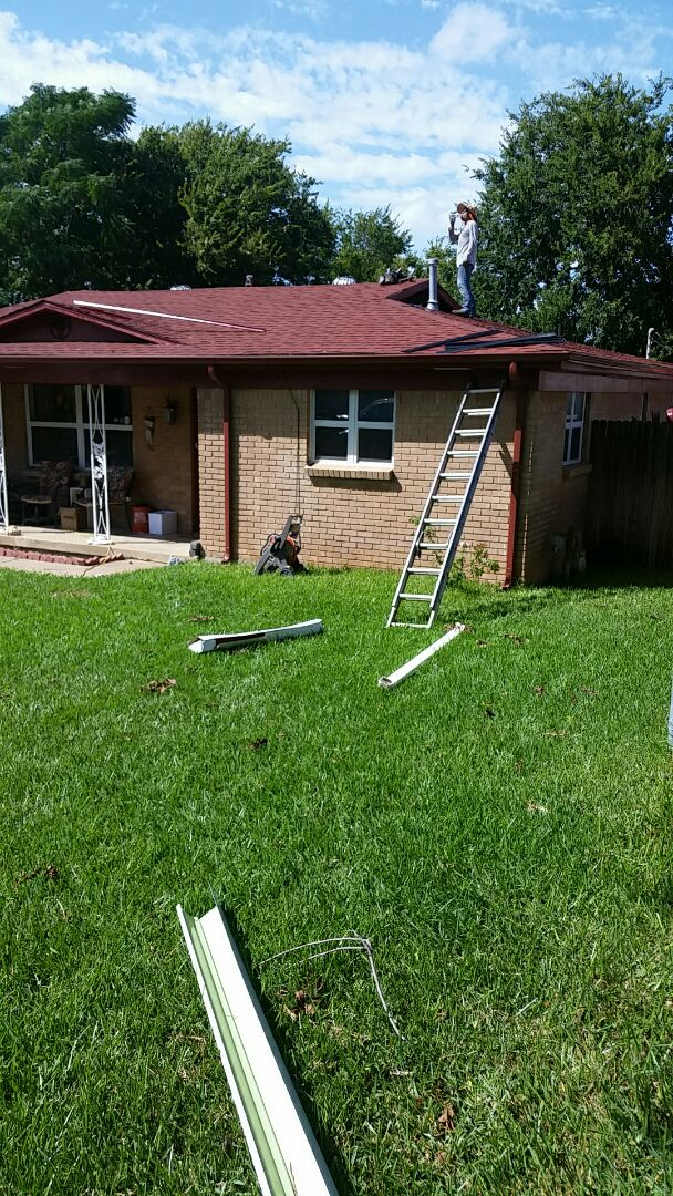 White Settlement, TX - Installing new gutters (Redwood) and leaf guards.