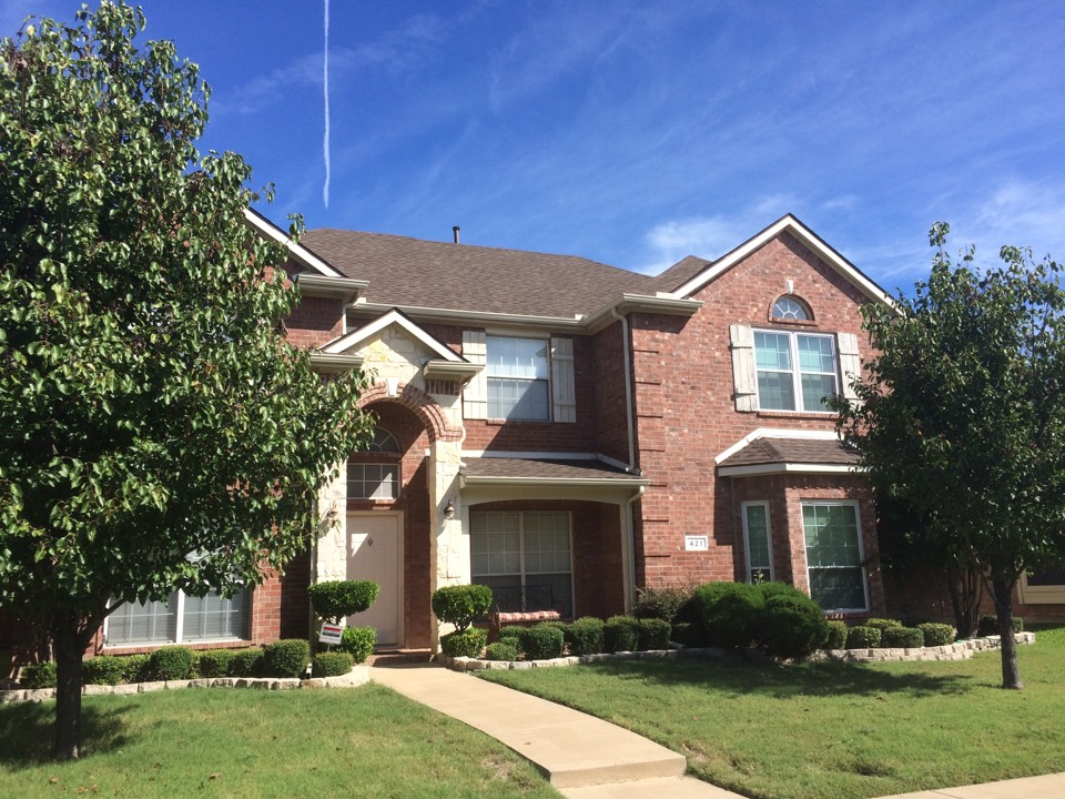 Lewisville, TX - New roof and gutters due to hail damage.  GAF Timberline HD (Barkwood)