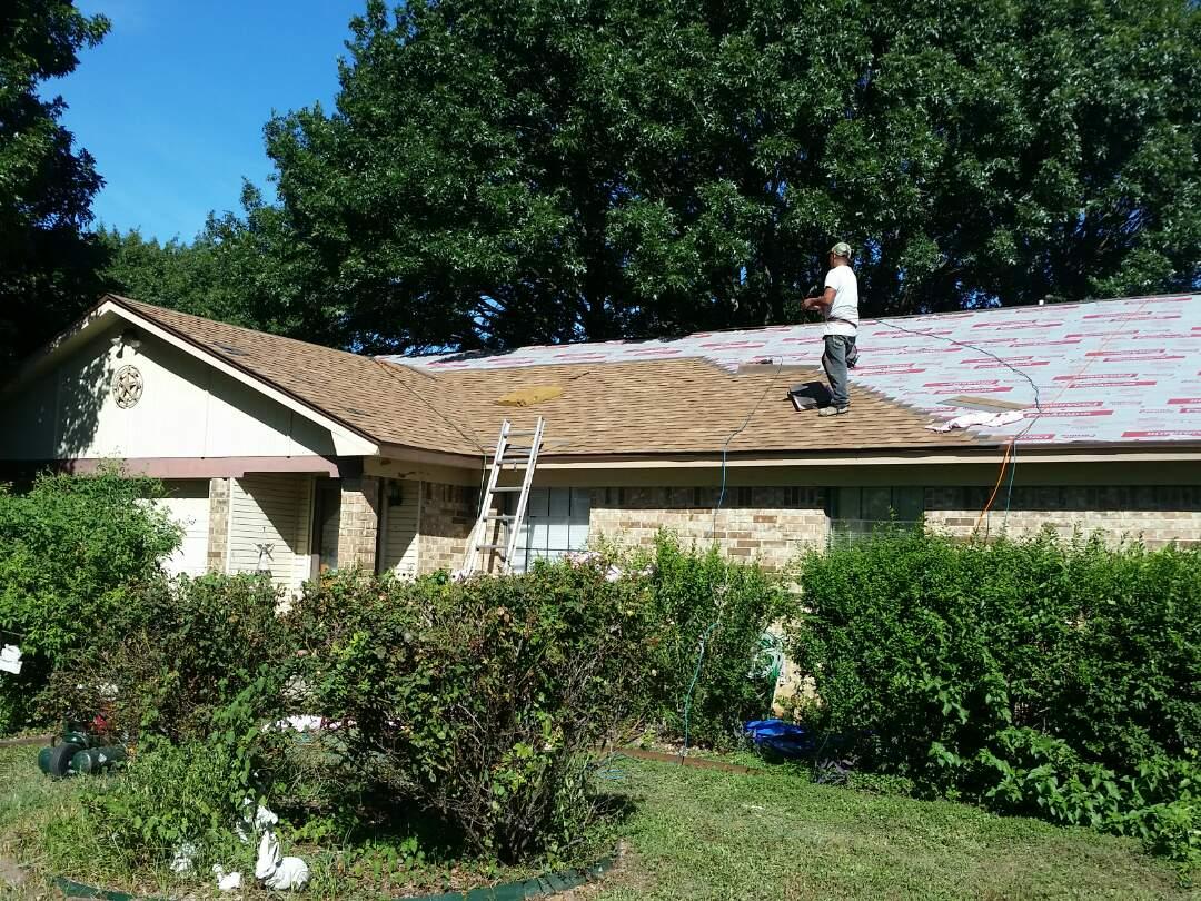 Arlington, TX - Roof and gutter replacement due to hail damage. Owens Corning Oakridge (Desert Tan)