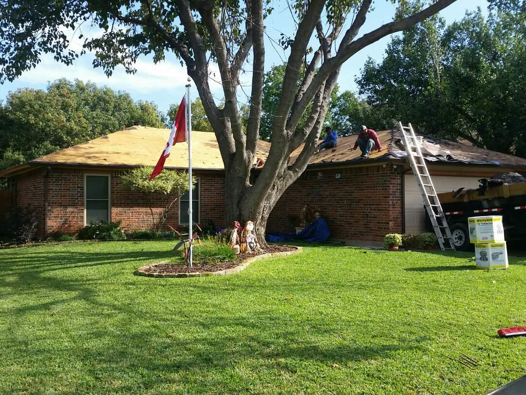 Fort Worth, TX - Installing Owens Corning Oakridge shingles -Desert Tan on hail damage roof.