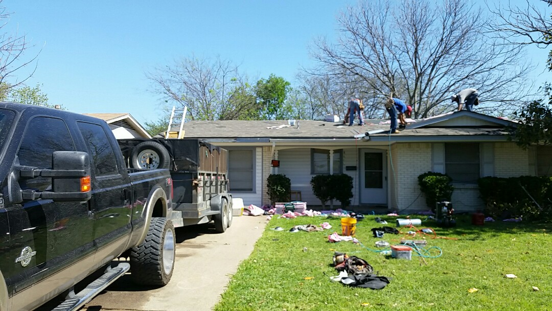 Mesquite, TX - Insurance claim for older white roof. Replacement shingle is a  year Owens corning in the color of driftwood with lifetime warranty.