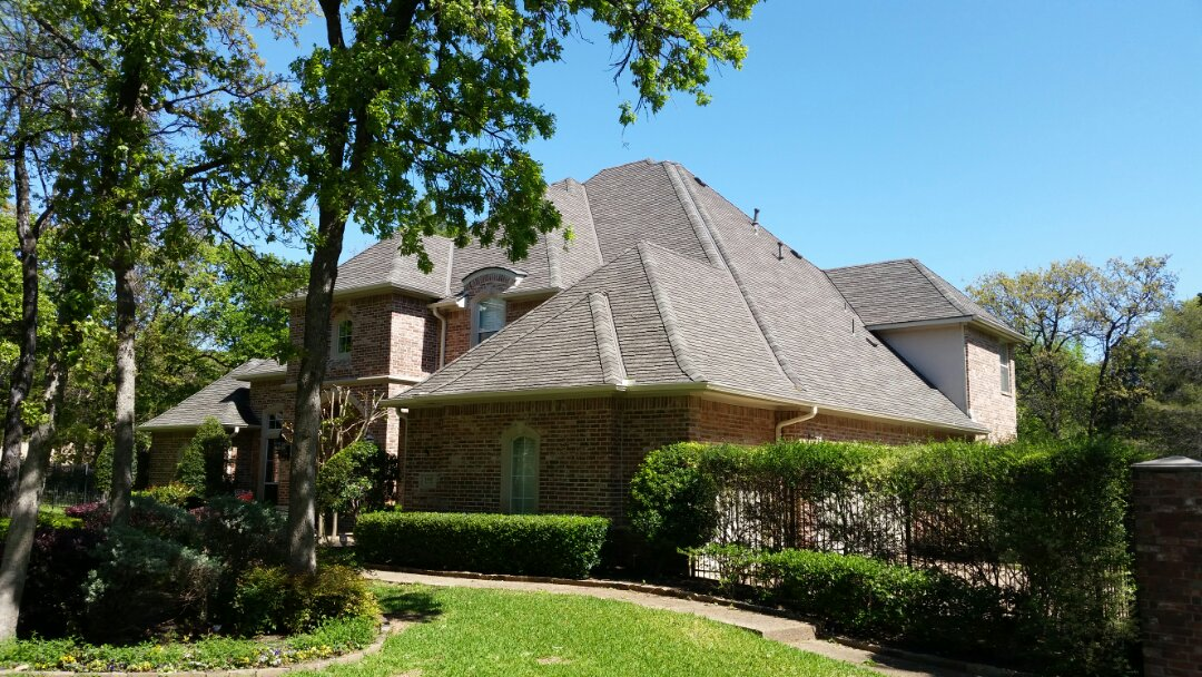 Southlake, TX - Installed GAF Glenwood shingle - (weathered wood) triple laminate class 4 shingle. Complete roof and gutter replacement due to hail damage.