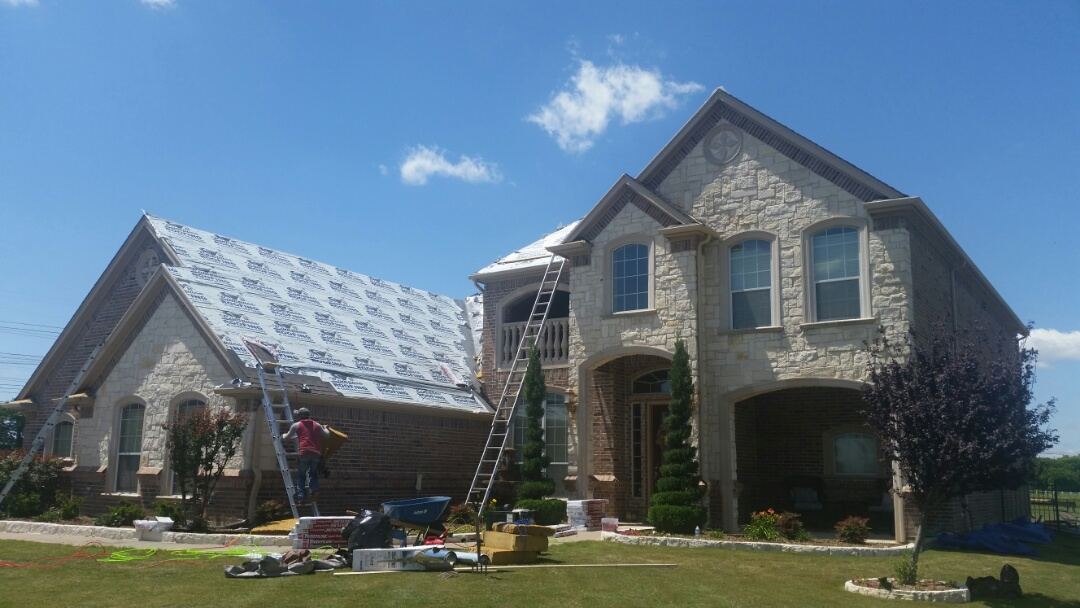 Haslet, TX - Installing new GAF Timberline NS roof with ZRidge due to hail damage.