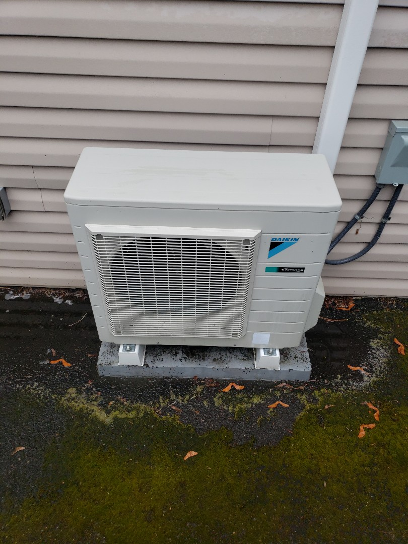 Portland, OR - Maintenance on a Daikin Heat Pump; cleaned outdoor unit