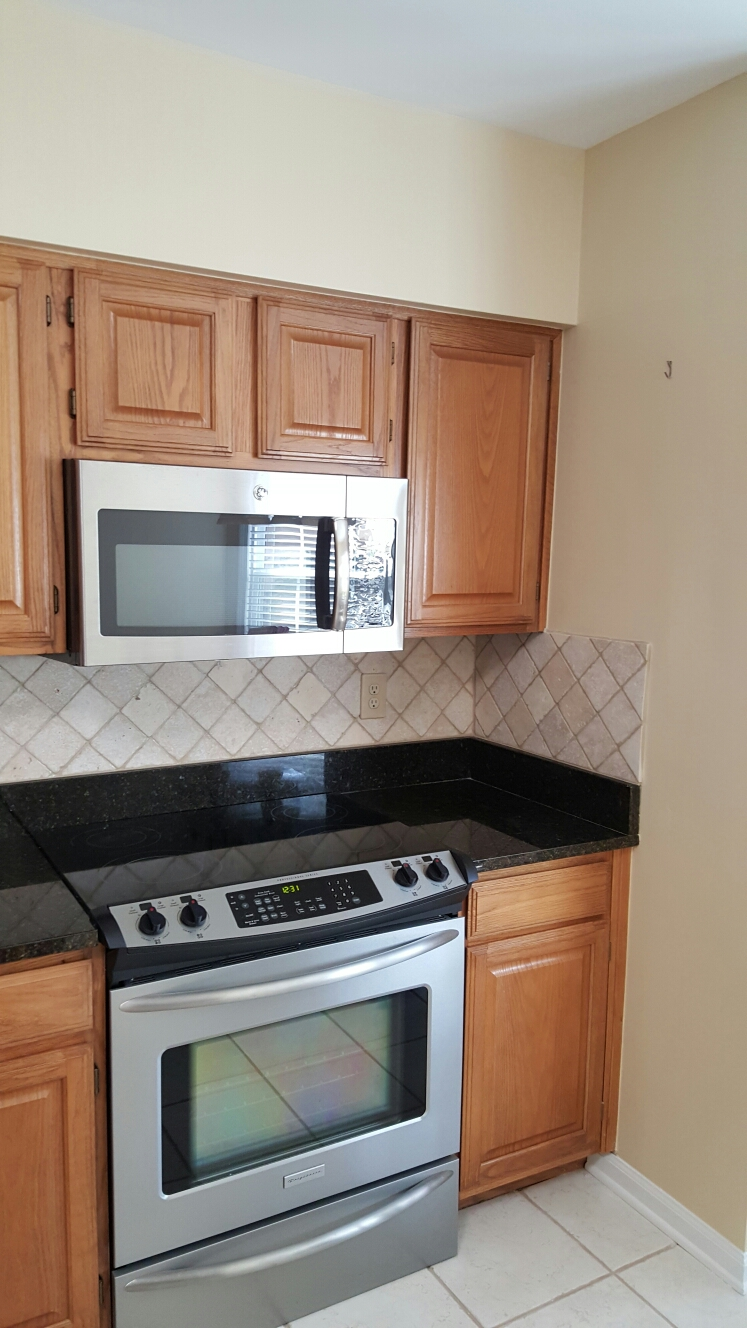 Roswell, GA - Kitchen backsplash and painting.