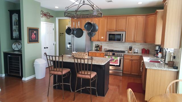Alpharetta, GA - Kitchen renovation: granite counter tops, wine cooler/dry bar, paint island cabinet.