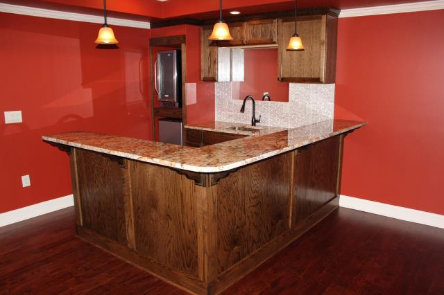 Buford, GA - Basement finish: bar, family room, theater, bedroom, exercise room, full bathroom, 1/2 bath.
