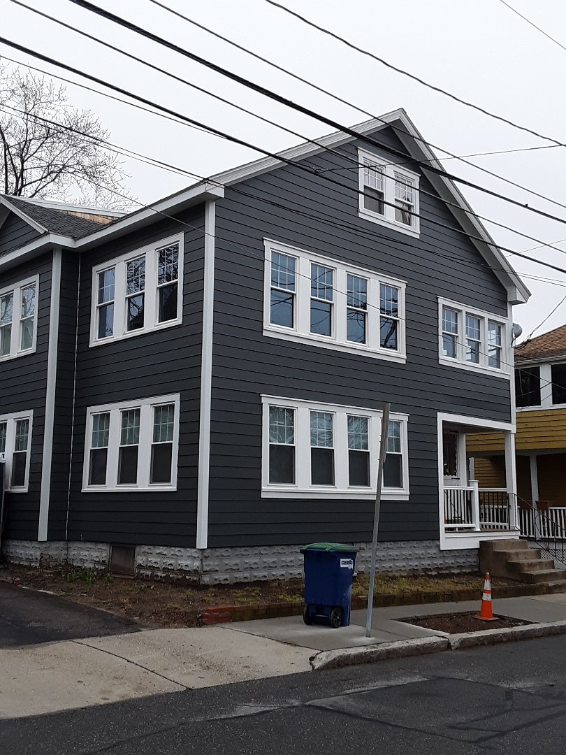Somerville, MA - This Iron Gray Smooth Lap Hardie siding really brings new life to an old house