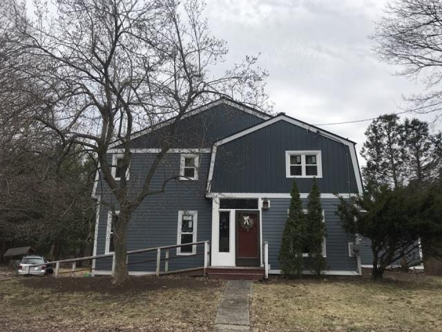 Marlborough, MA - This house started out as a a standard looking house seen in many locations , with the new Hardie Siding both the board and barren and  in blue  clap board bring it to life. It is now the stand out on the street.