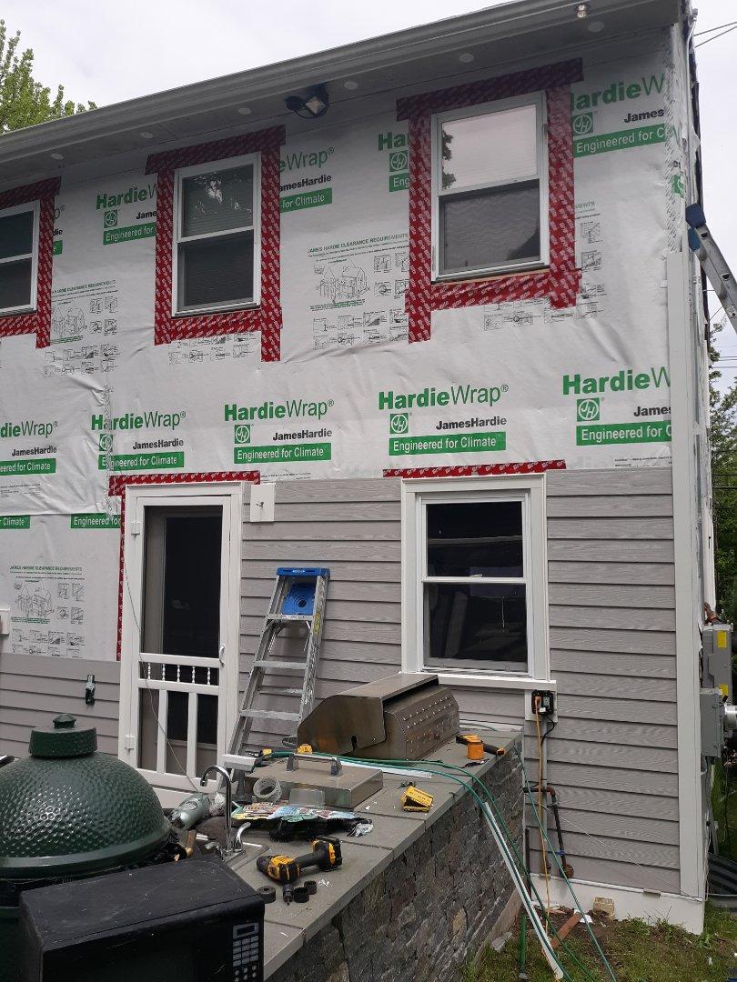 Brookline, MA - Installing new James hardie plank on this Brookline home