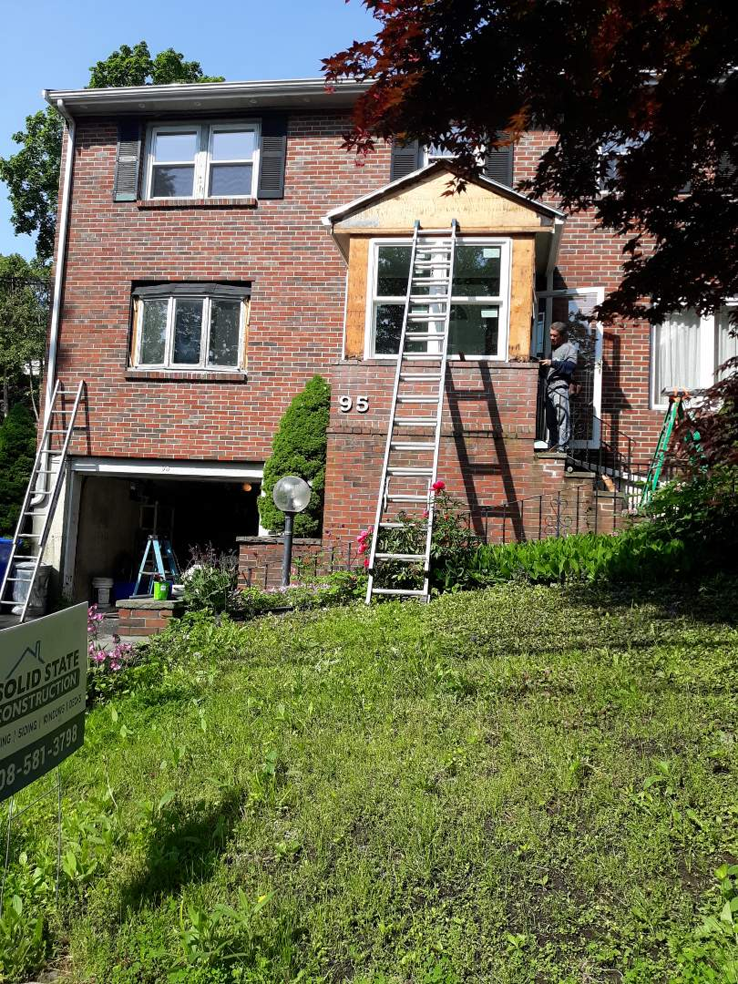 Brookline, MA - Closing off opening on one side of porch and installing new window on front at this hardie plank job