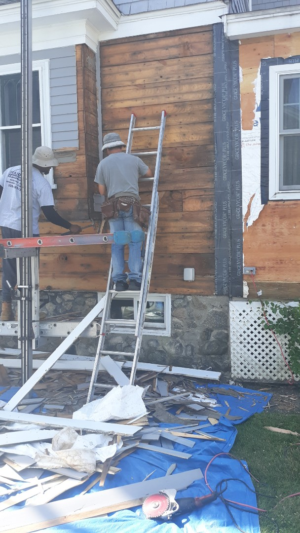 Lowell, MA - Removing existing wood siding to prep for installation of hardie plank
