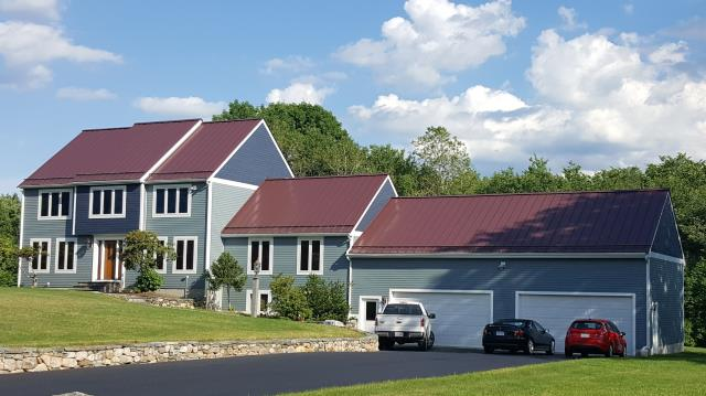 Shrewsbury, MA - We re-sided this home with a combination of James Hardie clapboard siding in Boothbay Blue and James Hardie shingles in Evening Blue. We also build a new back deck using Azek Autumn Chestnut decking and Timbertech Radiance Rails. The colors create a fantastic contrast with the Drexel Galvalume Standing Seam roof in Burgundy.