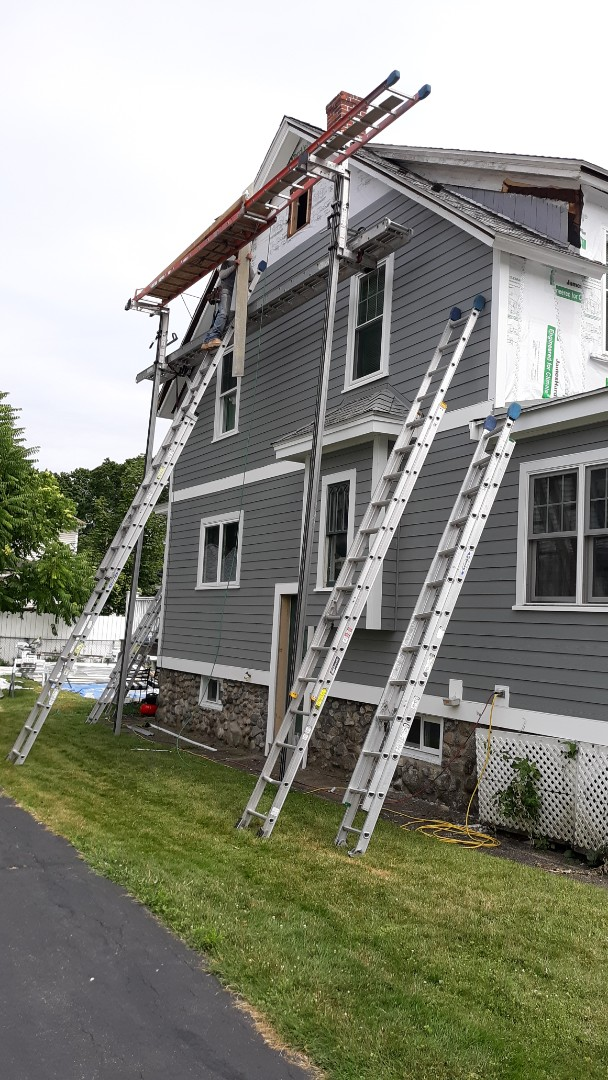 Lowell, MA - Installing new hardie plank in slate grey with white hardie and pvc trim