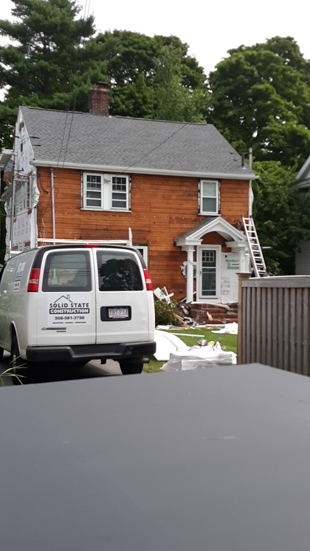 Boston, MA - Stripping and preparing home for hardie plank installation