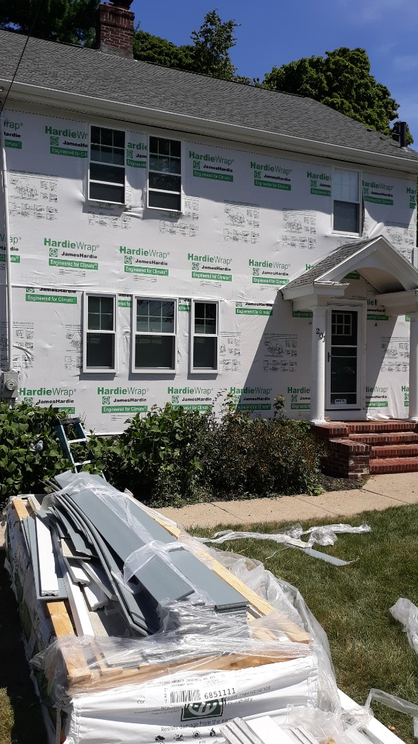 Boston, MA - Hardie house installer prior to the install of Hardie plank