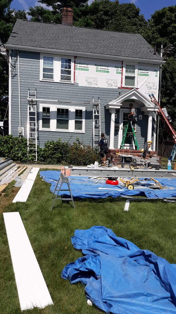 Boston, MA - Final touches on this newly installed james hardie plank project