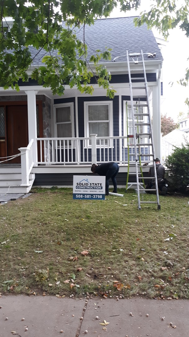 Belmont, MA - Installi g new seamless gutters on this recently completed James Hardie plank install