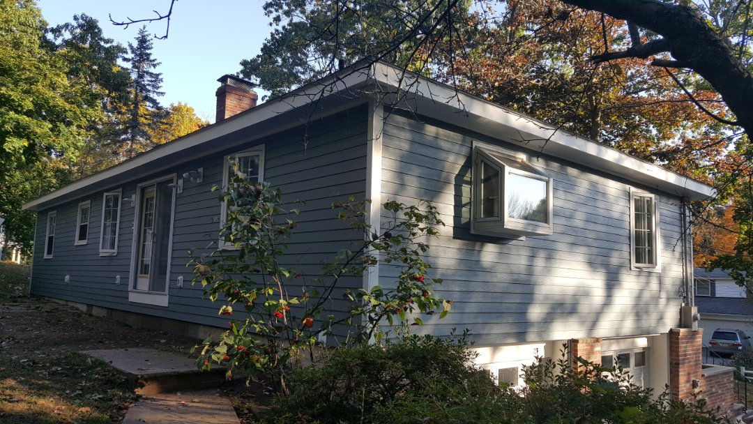 Andover, MA - #James Hardie Siding Install is substantially done in this home in Andover.  Came out beautifully!  Photo taken at the back right side view of the home. #SolidStateConstructionMA #MyHardieHome #FiberCement