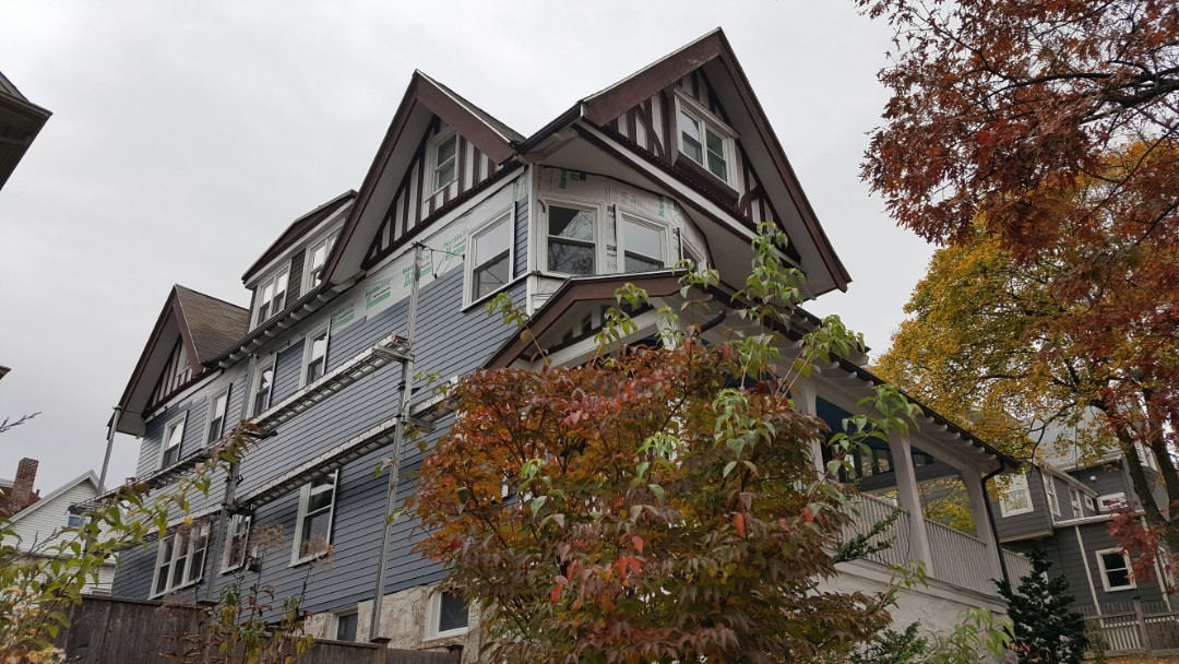 Boston, MA - Jamaica Plain, MA.  Checking on a progress of our crew in installing #JamesHardie #FiberCementSiding in this grand home.  #SolidStateConstructionMA