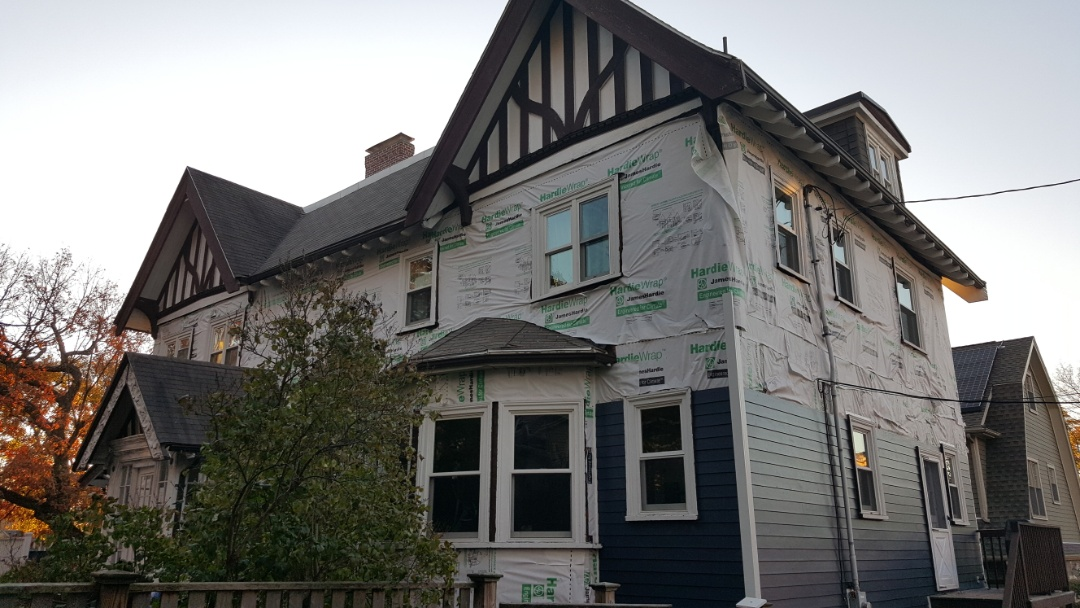 Boston, MA - After being rained out yesterday, our crew are back again installing #JamesHardie #FiberCementSiding  in this grand home in Jamaica Plain, MA.  #SolidStateConstructionMA