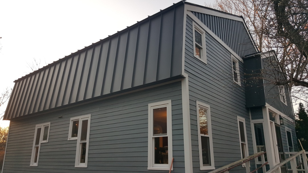 Marlborough, MA - Taking After Photos of this home in Marlborough, MA where we installed #JamesHardie #FiberCement #Clapboard #Siding.   #SolidStateConstructionMA  #MyHardieHome